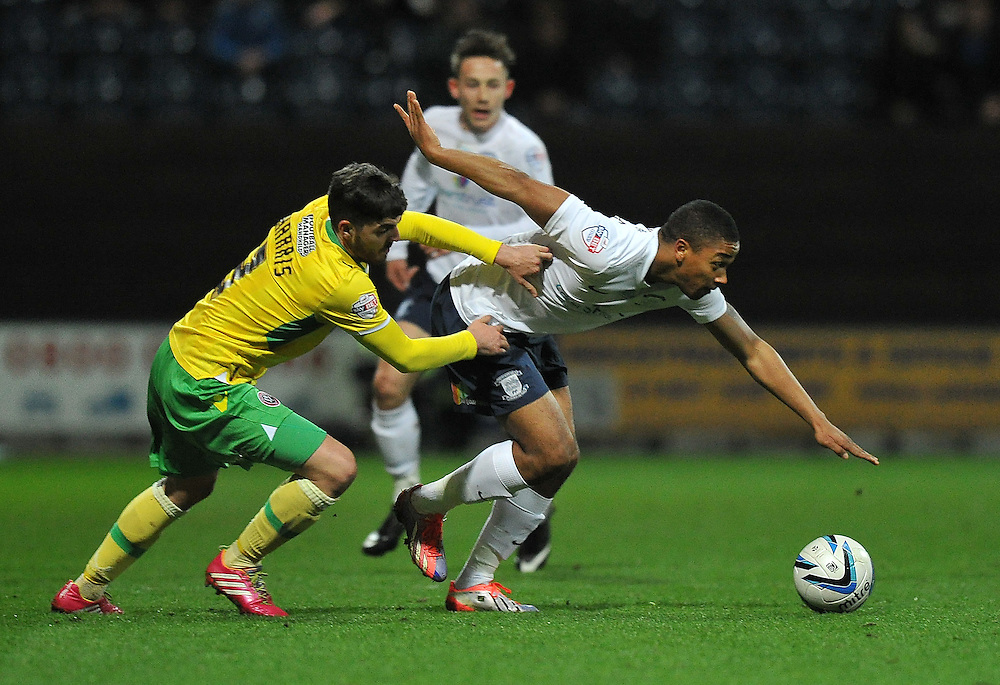 Preston North End's Chris Humphrey and Sheffield United's Robert Harris battle for the ball <br /> <br /> Photo by Dave Howarth/CameraSport<br /> <br /> Football - The Football League Sky Bet League One - Preston North End v Sheffield United - Monday 17th March 2014 - Deepdale - Preston<br /> <br /> © CameraSport - 43 Linden Ave. Countesthorpe. Leicester. England. LE8 5PG - Tel: +44 (0) 116 277 4147 - admin@camerasport.com - www.camerasport.com