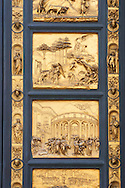 """Scenes from the early Renaissance """" Gates of Paradise"""" door of the Baptistry of Florence ( Battistero di San Giovanni ) made by Ghiberti in 1425 , made in bronze and guilded in gold. The Bapistry of the Duomo, Florence Italy .<br /> <br /> If you prefer you can also buy from our ALAMY PHOTO LIBRARY  Collection visit : https://www.alamy.com/portfolio/paul-williams-funkystock/romanesque-art-antiquities.html . Type -   Florence Baptistry  - into the LOWER SEARCH WITHIN GALLERY box. Refine search by adding background colour, place, museum etc<br /> <br />  Visit our MEDIEVAL ROMANESQUE PHOTO COLLECTIONS for more   photos  to download or buy as prints https://funkystock.photoshelter.com/gallery-collection/Medieval-Romanesque-Art-Antiquities-Historic-Sites-Pictures-Images-of/C0000uYGQT94tY_Y .<br /> <br /> Visit our ITALY PHOTO COLLECTION for more   photos of Italy to download or buy as prints https://funkystock.photoshelter.com/gallery-collection/2b-Pictures-Images-of-Italy-Photos-of-Italian-Historic-Landmark-Sites/C0000qxA2zGFjd_k<br /> .<br /> <br /> Visit our MEDIEVAL PHOTO COLLECTIONS for more   photos  to download or buy as prints https://funkystock.photoshelter.com/gallery-collection/Medieval-Middle-Ages-Historic-Places-Arcaeological-Sites-Pictures-Images-of/C0000B5ZA54_WD0s"""