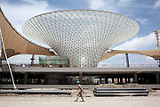 A worker walks through Sunshine Valley, a series of funnel-like structure that straddles the Expo axis, at the main 2010 World Expo site under construction in Shanghai, China on 13 July 2009. The World Expo drew in over 70 million visitors during its six months duration.