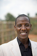 May0016089 . Daily Telegraph..Features.. Prince, the local manager of Rwanda Aid. Prince was a Tutsi refugee of the 1994 genocide, imprisoned and brutally tortured by Hutus he managed to survive the slaughter and was helped through school by David and Sally Chaplin and now works for them..Rwanda Aid is a British charity and recipient of funds from the Daily Telegraph's 2005 Christmas appeal...Rwanda 28 August 2009