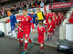 06.09.2011, Wembley Stadium, London, GBR, UEFA EURO 2012, Qualifikation, England vs Wales, im Bild Wales' captain Aaron Ramsey leads his side out to face England during the UEFA Euro 2012 Qualifying Group G match at Wembley Stadium on 6/9/2011. EXPA Pictures © 2011, PhotoCredit: EXPA/ Propaganda Photo/ David Rawcliff +++++ ATTENTION - OUT OF ENGLAND/GBR+++++