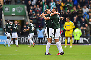 Peter Grant (24) of Plymouth Argyle and Ryan Edwards (5) of Plymouth Argyle hug at full time after a 1-0 win over AFC Wimbledon during the EFL Sky Bet League 1 match between Plymouth Argyle and AFC Wimbledon at Home Park, Plymouth, England on 6 October 2018.