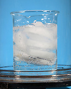 Ice water is placed in a beaker and the air is removed in a vacuum chamber.  Then the air pressure is lower that the waters vapor pressure the liquid will boil.