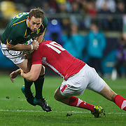 Butch James, South Africa, is tackled by Rhys Priestland, Wales, during the Wales V South Africa, Pool D match during the Rugby World Cup in Wellington, New Zealand,. 11th September 2011. Photo Tim Clayton
