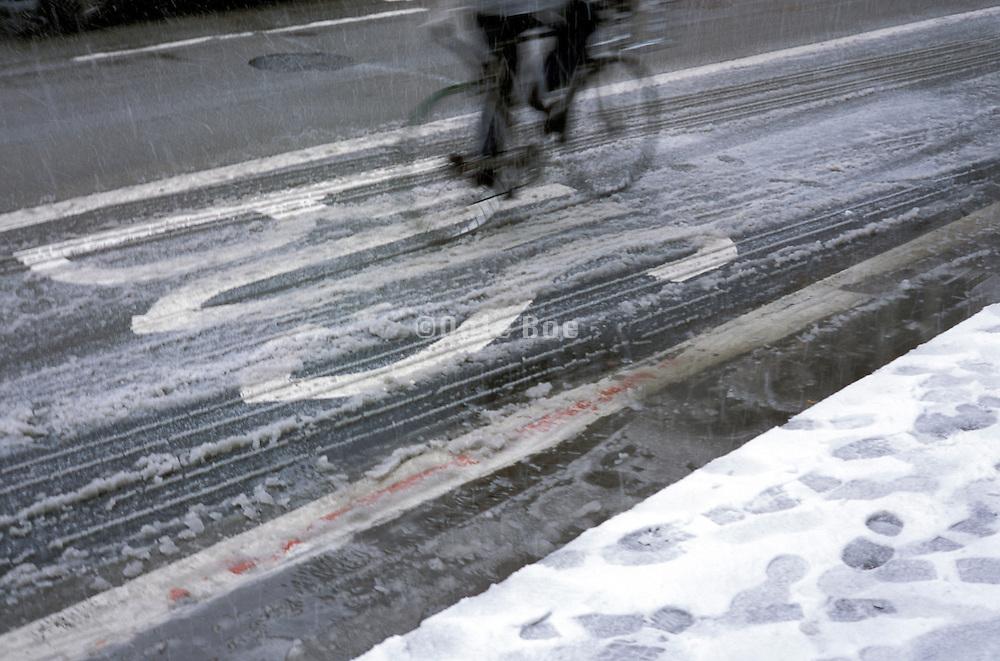 bike rider using bus lane on snowy street