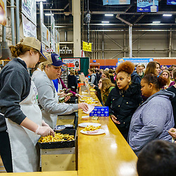 Harrisburg, PA / USA - January 9, 2020: Fresh cut and fried potatoes are another favorite at the PA Farm Show in the food court areas.