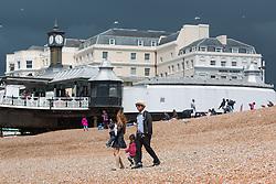 © Licensed to London News Pictures. 25/06/2016. Brighton, UK. Dark rain clouds look behind the buildings on Brighton's Promenade. Photo credit: Hugo Michiels/LNP