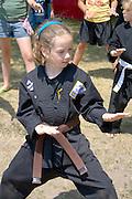 Young girl member of Kuk Sool Won school teaching martial arts. Dragon Festival Lake Phalen Park St Paul Minnesota USA