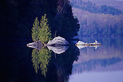 Reflections on lake - Quebec, Canada.