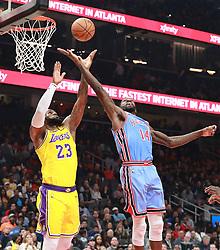 February 12, 2019 - Atlanta, GA, USA - Los Angeles Lakers' LeBron James grabs a rebound against Atlanta Hawks' Dewayne Dedmon during the first half on Tuesday, Feb. 12, 2019 in Atlanta, Ga. (Credit Image: © Curtis Compton/Atlanta Journal-Constitution/TNS via ZUMA Wire)
