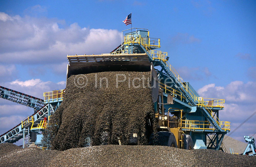 A tipper pours aggregates at a facility owned by the construction company, Hanson, on 17th April 1999, in Raleigh, North Carolina, USA.