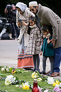 The day after the death at age 99 of Prince Phillip, the Duke of Edinburgh, consort to Queen Elizabeth II, mourners lay flowers (with wrappers removed) at Cambridge Gate, Windsor Castle where the Queen has been isolating throughout the Coronavirus pandemic, on 10th April 2021, in London, England.