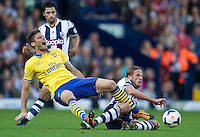 Arsenal's Olivier Giroud shows the pain after this tackle from West Bromwich Albion's Jonas Olsson<br /> <br /> Photo by Stephen White/CameraSport<br /> <br /> Football - Barclays Premiership - West Bromwich albion v Arsenal - Sunday 6th October 2013 - The Hawthorns - West Bromwich<br /> <br /> © CameraSport - 43 Linden Ave. Countesthorpe. Leicester. England. LE8 5PG - Tel: +44 (0) 116 277 4147 - admin@camerasport.com - www.camerasport.com