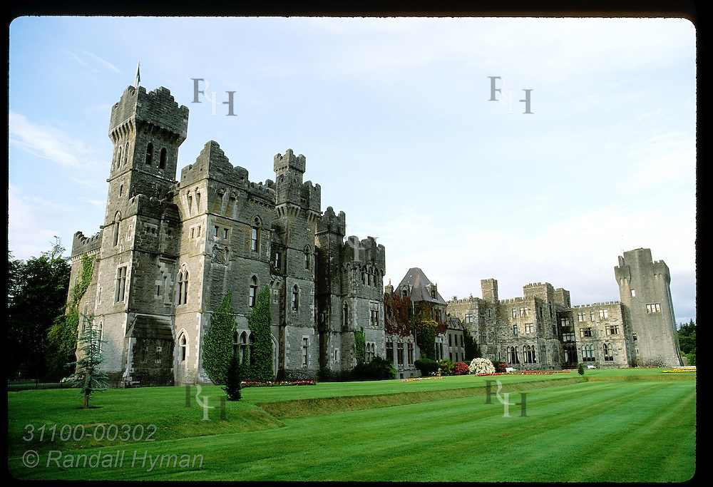 Ashford Castle, an 83-room hotel among Ireland's best, looms over greens on lakeshore side; Cong. Ireland