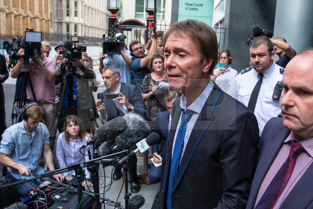 © Licensed to London News Pictures. 18/07/2018. London, UK. An emotional SIR CLIFF RICHARD (2-R) as he leaves the Rolls Building of the High Court in London after winning his claim for damages against the BBC for loss of earnings. The 77-year-old singer sued the corporation after his home in Sunningdale, Berkshire was raided following allegations of sexual assault made to Metropolitan Police. Photo credit: Rob Pinney/LNP