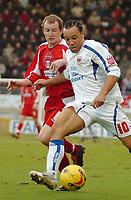 Photo: Ed Godden.<br />Leyton Orient v Carlisle United. Coca Cola League 2. 11/02/2006.<br />Joe Keith (L) challenges Carlisle's Karl Hawley.