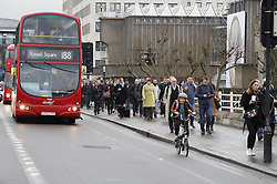 © Licensed to London News Pictures. 09/01/2017. London, UK. Commuters cross Waterloo Bridge  as a 24 hour London Underground tube strike takes hold.  All Zone one tube stations are closed until 6PM tonight after members of the RMT and the Transport Salaried Staffs' Association unions walked out after talks with TFL collapsed.  Photo credit: Peter Macdiarmid/LNP