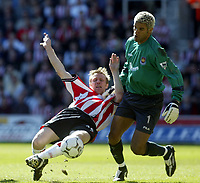 Photo. ANDY SCAYSBROOK<br />05/04/2003 Southampton  v West Ham, FA Barclaycard Premiership<br />David James tangles with Ormerod