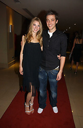 MARK EMMS and JESSICA WELLS at a party to launch Three's A Crowd held at the Mayfair Hotel, Berkley Street, London on 5th December 2006.<br />