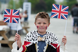 Plymouth, UK  29/04/2011. The Royal Wedding of HRH Prince William to Kate Middleton. A young boy wearing a prince costume waits for the start of the wedding in Plymouth. Photo credit should read London News Pictures. Please see special instructions. © under license to London News Pictures