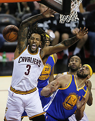 The Cleveland Cavaliers' Derrick Williams (3) is fouled going up for a bucket against the Golden State Warriors in the fourth quarter during Game 4 of the NBA Finals at Quicken Loans Arena in Cleveland on Friday, June 9, 2017. The Cavs won, 137-116, trimming their series deficit to 3-1. (Photo by Leah Klafczynski/Akron Beacon Journal/TNS) *** Please Use Credit from Credit Field ***