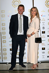 attends the National Film Awards at the Porchester Hall in London, UK. 28 Mar 2018 Pictured: Teddy Sheringham and Kristina Andriotis. Photo credit: MEGA TheMegaAgency.com +1 888 505 6342