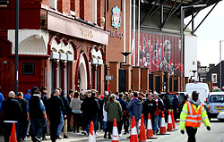Fans arriving at the ground ahead of the Premier League match at Anfield, Liverpool.