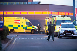 © Licensed to London News Pictures 30/12/2020.        Dartford, UK. Ambulances coming and going at Darent Valley Hospital in Dartford, Kent. The NHS is    overwhelmed with Covid-19 patients across the country with some ambulances waiting outside hospitals for hours with patients onboard. Photo credit:Grant Falvey/LNP