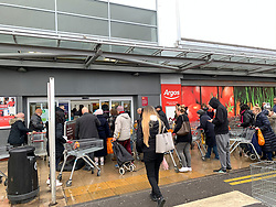 © Licensed to London News Pictures. 14/03/2020. London, UK. Members of the public queue outside Sainsbury's on Ladbroke Grove in west London ahead of it opening at 7am. New cases of the COVID-19 strain of Coronavirus are being reported daily as the government outlines it's plans for delaying the outbreak. Photo credit: Ben Cawthra/LNP