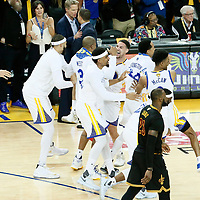 12 June 2017: The Golden State Warriors team celebrates next to Cleveland Cavaliers forward LeBron James (23) during the Golden State Warriors 129-120 victory over the Cleveland Cavaliers, in game 5 of the 2017 NBA Finals, at the Oracle Arena, Oakland, California, USA.