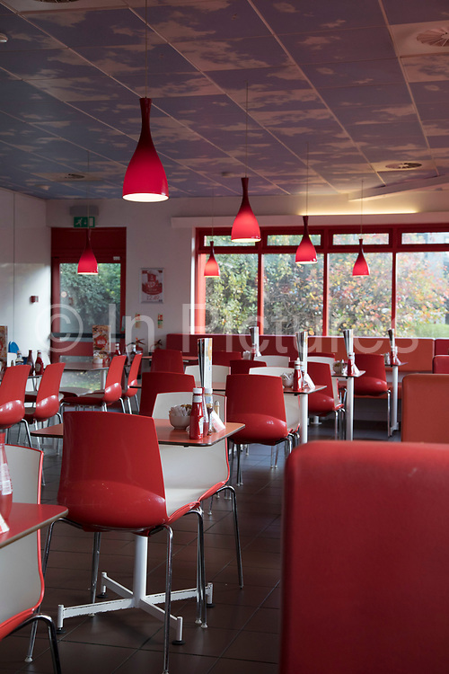 Interior of the Little Chef restaurant in Shrewsbury, England, United Kingdom. Little Chef is a chain of roadside restaurants in the United Kingdom, founded in 1958 by entrepreneur Sam Alper, and modelled on American diners. It specialises in the Olympic Breakfast, its version of a full English breakfast.