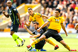 Bernardo Silva of Manchester City is tackled by Raul Jimenez of Wolverhampton Wanderers - Mandatory by-line: Robbie Stephenson/JMP - 25/08/2018 - FOOTBALL - Molineux - Wolverhampton, England - Wolverhampton Wanderers v Manchester City - Premier League