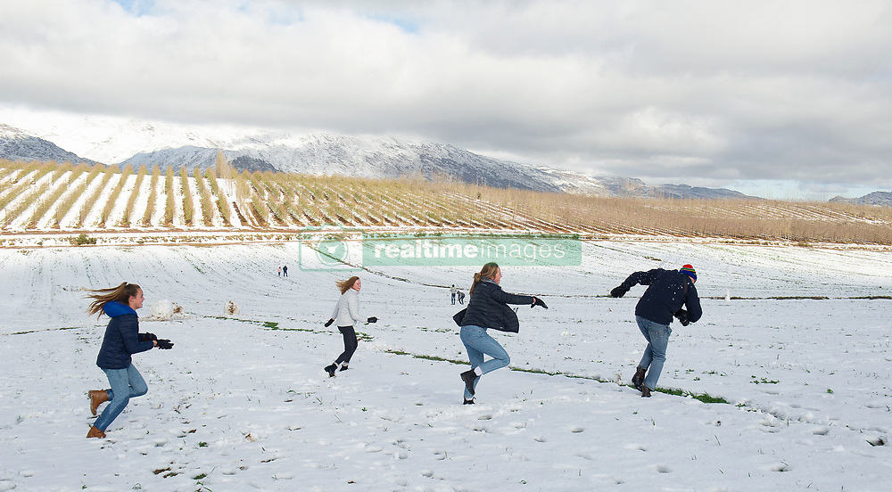 South Africa - Cape Town - 12 June 2020 - Snowfall is usually predicted at this time of year when the Western Cape Winter cold front hits hard. Snow covers the Matroosberg mountain ranges and high laying plateaus of Ceres including agricultural land. The snow attracts many visitors who enjoy themselves by building snowmen and throwing each other with snowballs. Despite South Africa being under level 3 lockdown, many people brought their families to marvel at the icy spectacle. Picture Courtney Africa/African News Agency(ANA)