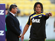 Rodney So'oialo walks past Hurricanes coach Colin Cooper.<br /> Super 14 rugby match - Hurricanes v Western Force at Westpac Stadium, Wellington. Saturday, 20 February 2010. Photo: Dave Lintott/PHOTOSPORT