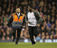 A pitch invader comes onto the pitch <br /> <br /> Europa League Group C- Tottenham vs Partizan Belgrade - White Hart Lane - England - 27th November 2014 - Picture David Klein/Sportimage