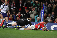 Lee Byrne dives over for the Welsh try.Invesco Perpetual match, Wales v New Zealand at the Millennium stadium in Cardiff on Sat 27th Nov 2010.  pic by Andrew Orchard, Andrew Orchard sports photography,
