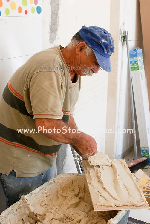 skilled Tiler at work