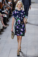A model walks the runway wearing Michael Kors Spring 2015 during Mecedes-Benz Fashion Week in New York on September 10th, 2014