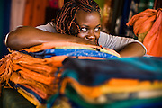 Woman selling textiles at the Village Artisanal de Ouagadougou, a cooperative that employs dozens of artisans who work in different mediums, in Ouagadougou, Burkina Faso, on Monday November 3, 2008.