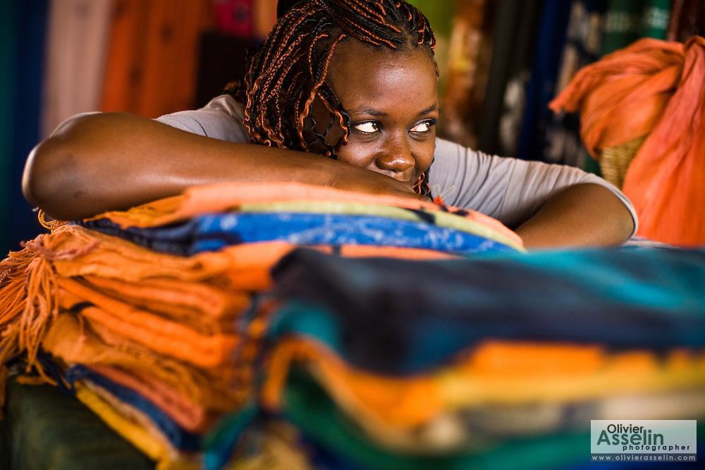 Woman selling textiles at the Village Artisanal de Ouagadougou, a cooperative that employs dozens of artisans who work in different mediums, in Ouagadougou, Burkina Faso, on Monday November 3, 2008.