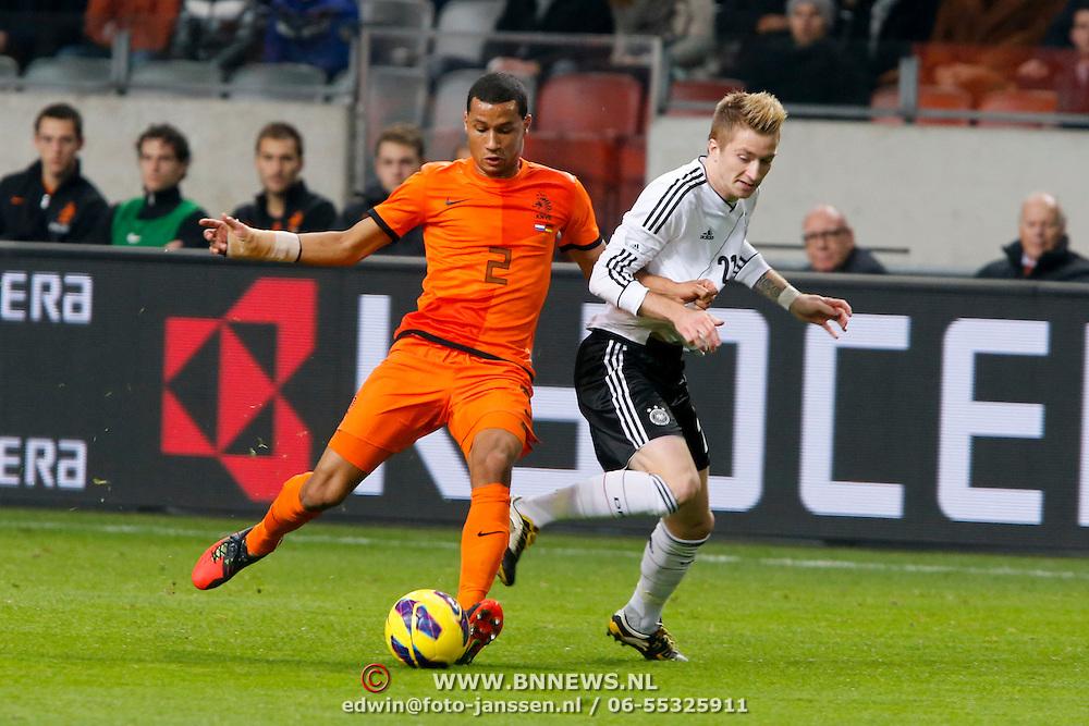 NLD/Amsterdam/20121114 - Vriendschappelijk duel Nederland - Duitsland, Ricardo van Rhijn in duel met Marco Reus