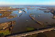 Nederland, Limburg, Gemeente Maasgouw, 10-01-2011; hoogwater Maas, omgeving Maasbracht als gevolg van sneeuwsmelt en neerslag in de bovenloop van de rivier. In de voorgrond de brug van de A2, Roermond en Maasplassen aan de horizon..Meuse flood, Maasbracht area, high water due to snow melt and precipitation upstream. In the foreground bridge A2 motorway, Roermond on the horizon..luchtfoto (toeslag), aerial photo (additional fee required).© foto/photo Siebe Swart
