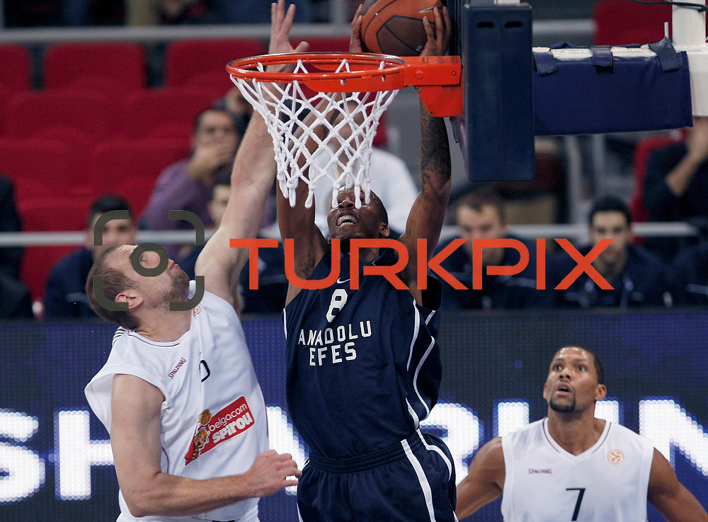 Anadolu Efes's Terence KINSEY (C) and Belgacom Spirou's Justin HAMILTON (R) during their Turkish Airlines Euroleague Basketball Group C Game 2 match Anadolu Efes between Belgacom Spirou  at Abdi Ipekci Arena in Istanbul, Turkey, Wednesday, October 26, 2011. Photo by TURKPIX