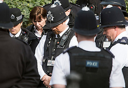 © Licensed to London News Pictures. 22/03/2018. London, UK. Members of the Police Force hang their heads as they hold a minutes silence at New Palace Yard, inside the grounds of the Houses of Parliament in Westminster, London at the time PC Palmer died, one year ago today in the Westminster Bridge Terror attack. A lone terrorist killed 5 people and injured several more, in an attack using a car and a knife. The attacker, 52-year-old Briton Khalid Masood, managed to gain entry to the grounds of the Houses of Parliament and killed police officer Keith Palmer. Photo credit: Ben Cawthra/LNP