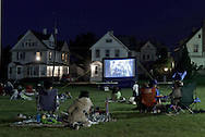 Middletown, New York - People watch a movie on an outdoor screen behind the Middletown YMCA on the night of June 15, 2012.