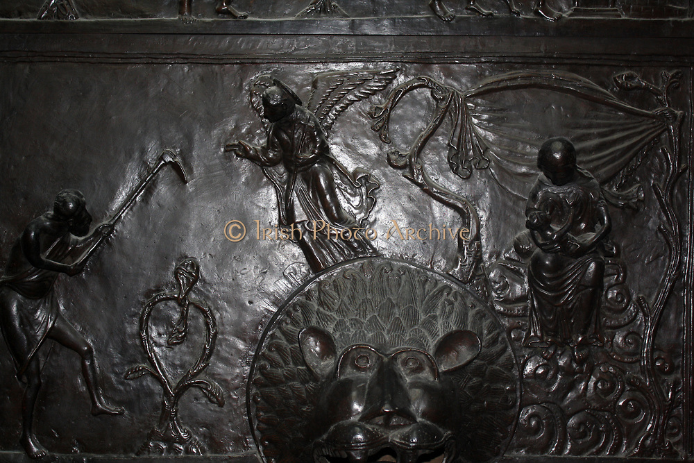 Detail from Bronze doors with scenes from the Old and New Testament in relief. Made at the order of St. Bernward, and set up by him in 1015 at St. Michael's Church, Hildesheim. They were since taken to the cathedral by his successor. This panel shows the Labours of Adam and Eve.