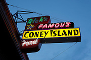 """A classic sign for """"Nicks Famous Coney Island Food"""" on Hawthorne street, a shopping district in SE Portland, Oregon."""