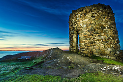 The first light of day is seen behind Lady's Tower in Elie, Fife. The structure was built in 1760 for Lady Janet Anstruther to use as a changing room prior to her morning bathing routine.