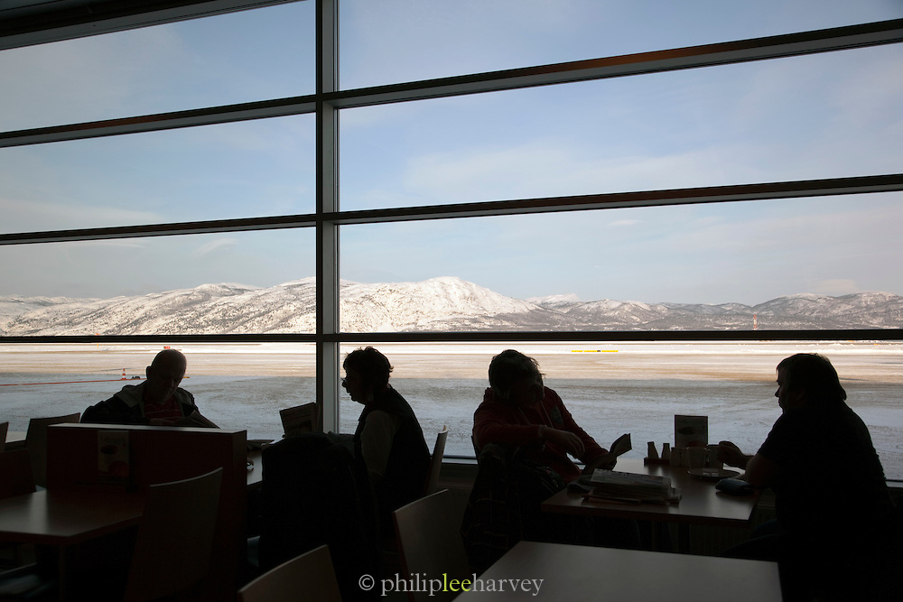 A cafe in Alta airport, looking over the frozen landscape and runway in Alta, Finnmark region, northern Norway