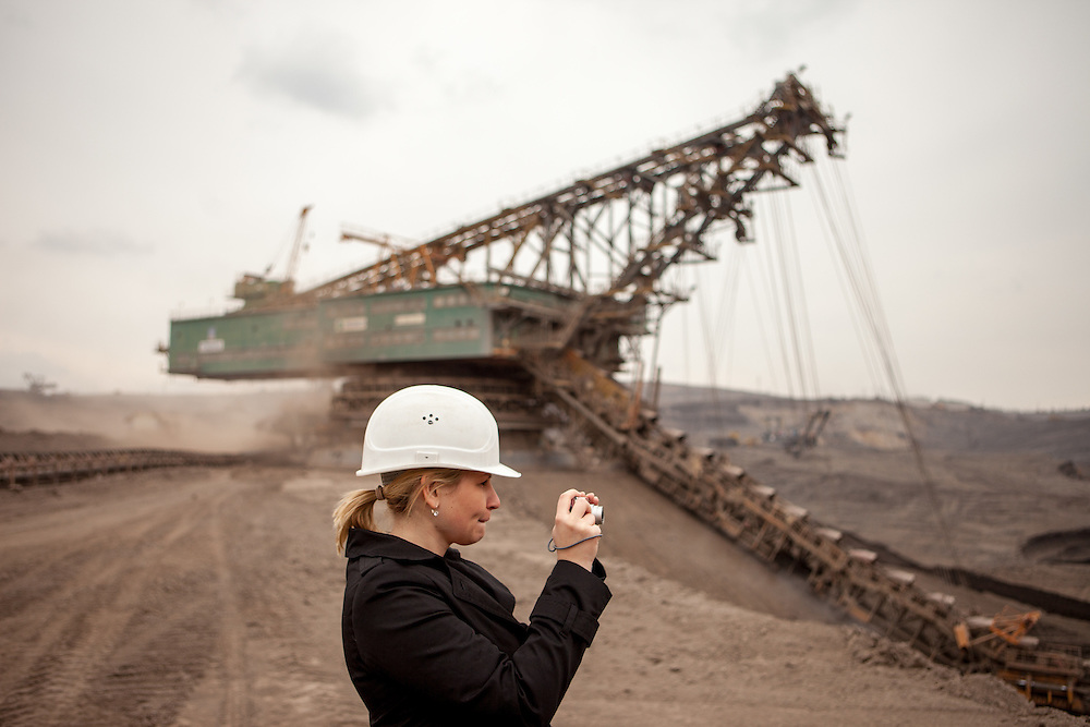 A visitor is taking a photograph of the North Bohemian brown coal Basin in Most, Czech Republic. The Czech Coal Group offers visitors the possibilty to see unique technical works in the mining areas of their surface mines.